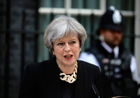 Britain's Prime Minister Theresa May speaks outside 10 Downing Street after an attack on London Bridge and Borough Market left 7 people dead and dozens injured. Photo: REUTERS/Kevin Coombs