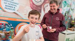 Cormac Murphy (9) and his father Michael at their Pro U Yogurt stand at Bloom. Photo: Doug O'Connor