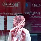 A man stands outside Qatar Airways office in Riyadh, Saudi Arabia. Photo: Reuters