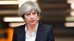 Embattled: Theresa May. Photo: Reuters