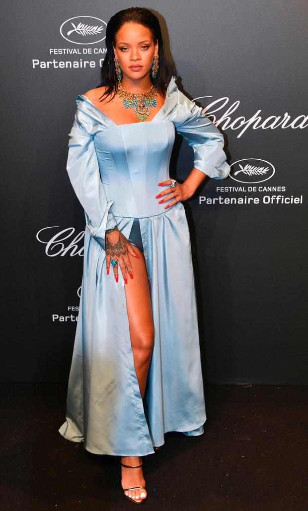 Barbadian singer Rihanna poses as she arrives for the Chopard