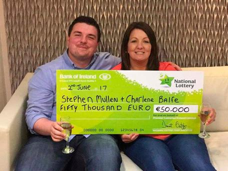 """Happy couple Stephen Mullen (24) from Navan, Co. Meath and his fiancé Charlene Balfe who said """"I do"""" to their €50,000 Scratch Card win today"""