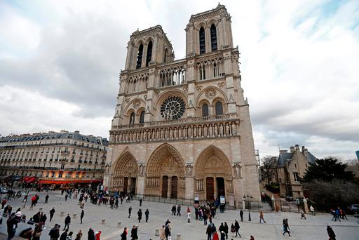 File photo: People walk past the entrance to the Notre Dame Cathedral in Paris REUTERS/Charles Platiau//File Photo