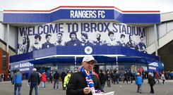 A Rangers fan arrives at the stadium prior to kickoff during the Ladbrokes Scottish Premiership match between Rangers and Celtic at Ibrox Stadium on April 29, 2017 in Glasgow, Scotland. (Photo by Michael Steele/Getty Images)