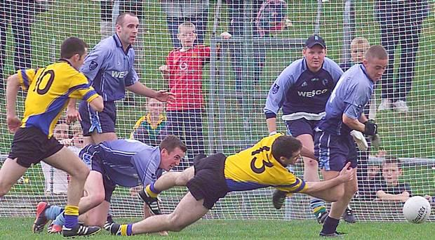Simonstown's Ronan McGrath (right) clears the danger after blocking Robert Cox (10) of Blackhall Gaels during a Meath SFC final in Navan. Picture: Fran Caffrey