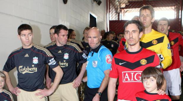 Gary Neville of Manchester United and Steven Gerrard of Liverpool line up in the tunnel ahead of the FA Barclays Premier League match between Manchester United and Liverpool at Old Trafford on March 21 2010 in Manchester, England. (Photo by John Peters/Manchester United via Getty Images)