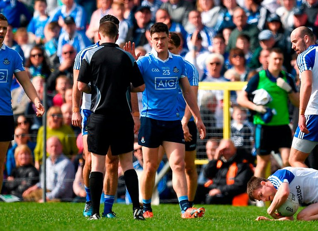Joe McQuillan calls over Connolly before issuing a black card against Monaghan. Photo: Ray McManus/Sportsfile