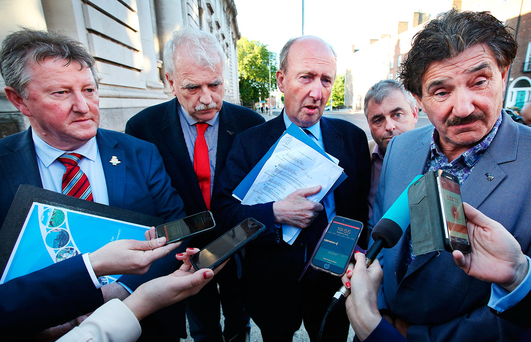 Members of the Independent Alliance including from left, Sean Canney, Finnian McGrath, Shane Ross, Kevin 'Boxer' Moran and John Halligan speak to media upon arrival at Government Buildings for a meeting with Fine Gael leader Leo Varadkar. Photo: Steve Humphreys