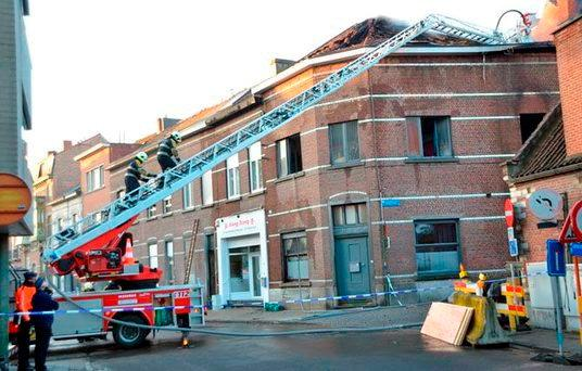 Firefighters at the scene of the deadly Leuven blaze