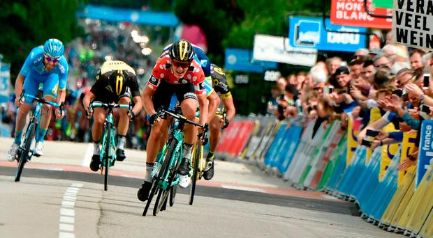 Netherlands' Koen Bouwman rides (1st-R) during the 184 km third stage of the 69th edition of the Criterium du Dauphine cycling race between Le Chambon-sur-Lignon and Tullins. GETTY