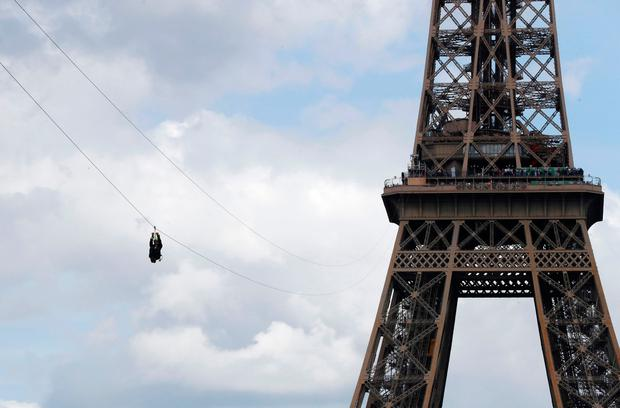 Riding the zip-line descending from the second floor of the Eiffel Tower to the Plateau Joffre on June 5, 2017 in Paris. Photo: FRANCOIS GUILLOT/AFP/Getty Images