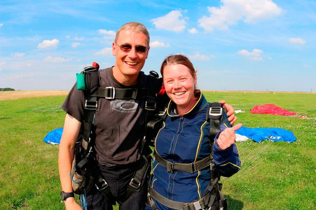 Undated handout photo issued by Animals Asia of Rosa King (right) with an unnamed instructor after taking part in a skydive to raise money for the charity. Animals Asia /PA Wire