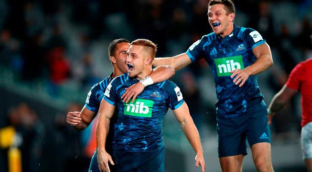 Ihaia West of the Blues (C) celebates his try with Sam Nock and Matt Duffie during the match between the Auckland Blues and the British & Irish Lions at Eden Park on June 7, 2017 in Auckland, New Zealand. (Photo by Phil Walter/Getty Images)