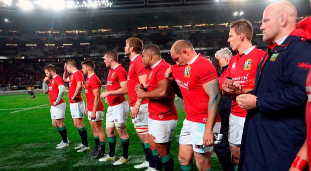 British and Irish Lions players stand dejected after the tour match at Eden Park,