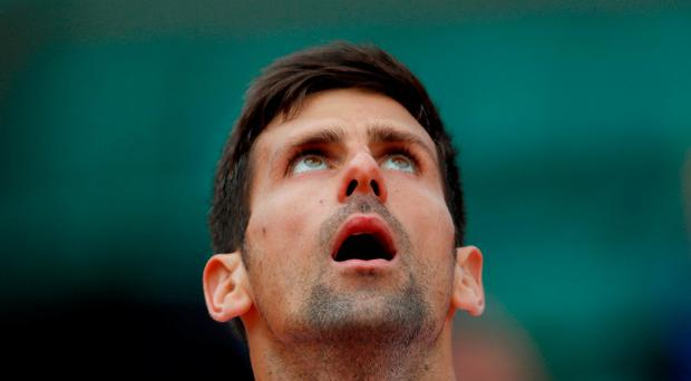 Serbia's Novak Djokovic reacts during his quarter final match against Austria's Dominic Thiem. Reuters / Gonzalo Fuentes