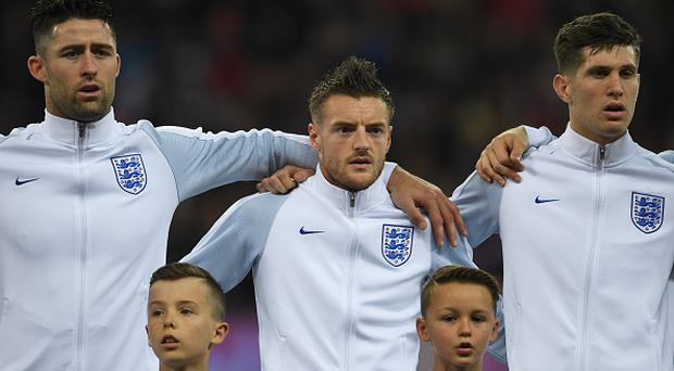 Gary Cahill, Jamie Vardy and John Stones of England line up prior to the international friendly match between England and Spain at Wembley Stadium on November 15, 2016 in London, England. (Photo by Mike Hewitt/Getty Images)