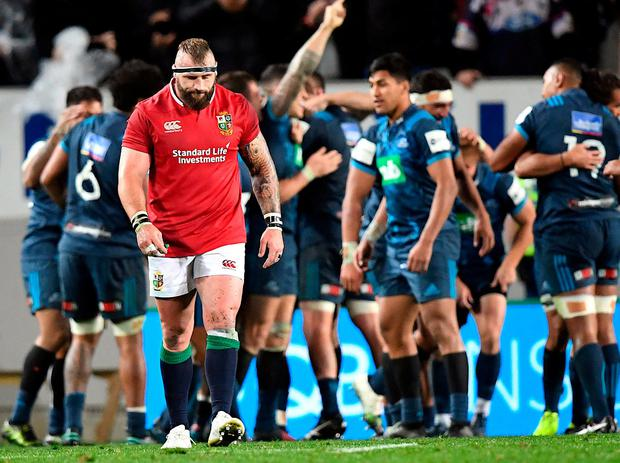 Joe Marler trudges off the field as the Auckland Blues players celebrate at the final whistle. Photo: Martin England/SNPA via Reuters