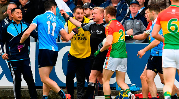 Diarmuid Connolly remonstrates with linesman Ciarán Branagan during the Leinster SFC quarter-final between Dublin and Carlow at O'Moore Park. Photo: Sportsfile