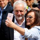 Jeremy Corbyn has a selfie taken with a woman at an election rally in Colwyn Bay. Picture: Reuters