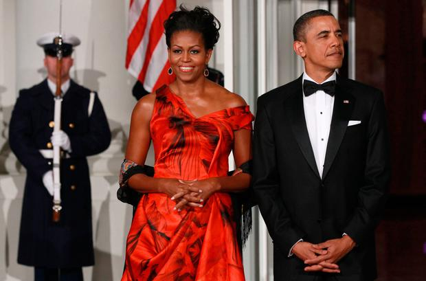 U.S. President Barack Obama (R) and first lady Michelle Obama (L) wait for Chinese President Hu Jintao to arrive for a State dinner at the White House January 19, 2011 in Washington, DC