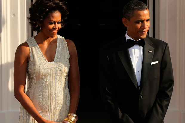 U.S. President Barack Obama (R) and first lady Michelle Obama (L) wait for the arrival of German Chancellor Angela Merkel and her husband Joachim Sauer on the North Portico before a state dinner at the White House June 7, 2011 in Washington, DC