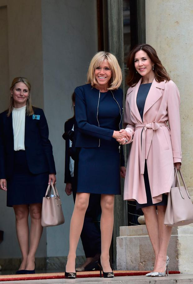 French president's wife Brigitte Macron shakes hands with Princess Mary of Denmark after a meeting on climate change, on June 6, 2017 at the Elysee palace in Paris. / AFP PHOTO / Christophe ARCHAMBAULT (Photo credit should read CHRISTOPHE ARCHAMBAULT/AFP/Getty Images)