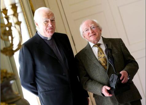President Michael D Higgins receiving the Fr. Aengus Finucane Award for Services to Humanity with Fr Jack Finucane (Picture: Maxwells)