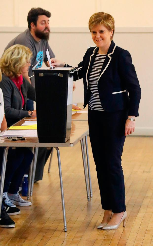First Minister Nicola Sturgeon casts her vote in the General Election at a polling station at Broomhouse Community Hall in Glasgow. PA