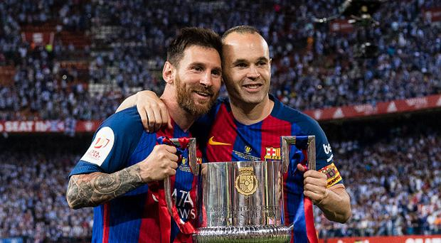Lionel Andres Messi of FC Barcelona (L) and Andres Iniesta Lujan of FC Barcelona (L) poses for photos with the trophy of Copa Del Rey, after the final between FC Barcelona and Deportivo Alaves at Vicente Calderon Stadium on May 27, 2017 in Madrid, Spain. (Photo by Power Sport Images/Getty Images)