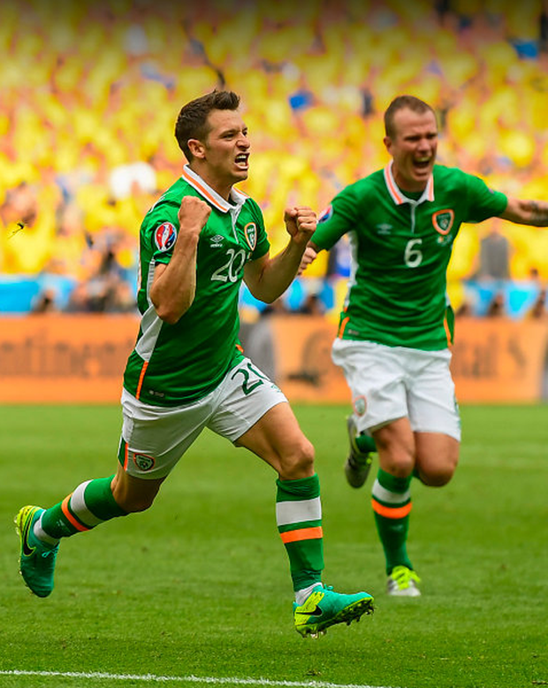 Wes Hoolahan celebrates his Euro 2016 goal against Sweden with Glenn Whelan - neither of whom are guaranteed their places in the starting line-up for Sunday's crunch World Cup qualifier against Austria. Photo: Sportsfile