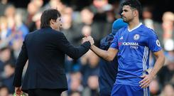 Chelsea's Italian head coach Antonio Conte (L) embraces Chelsea's Brazilian-born Spanish striker Diego Costa (R) during the English Premier League football match between Chelsea and Arsenal at Stamford Bridge in London on February 4, 2017. / AFP / Ian KINGTON /