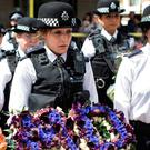 Grief: Police officers lay flowers near the scene of the London Bridge terrorist attacks this week