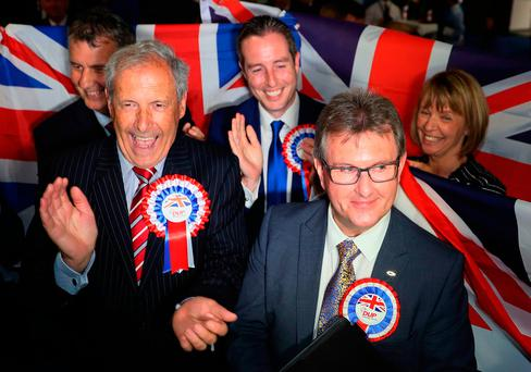 DUP candidate for Lagan Valley Jeffrey Donaldson (right) following his election at the Eikon Exhibition Centre in Lisburn as counting is under way for the General Election. Photo: Brian Lawless/PA Wire