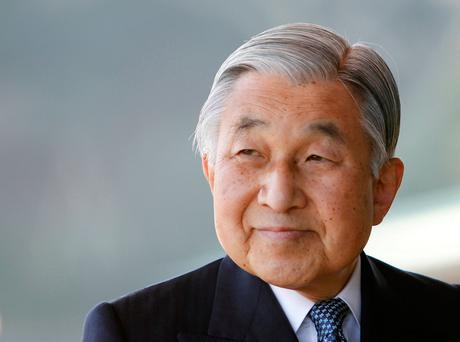 Japan's Emperor Akihito smiles at the Imperial Palace in Tokyo February 23, 2011. REUTERS/Kim Kyung-Hoon/File Photo