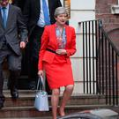 Prime Minister Theresa May leaves Conservative Party HQ in Westminster, London, as her future as Prime Minister and leader of the Conservatives was being openly questioned after her decision to hold a snap election disastrously backfired. Rick Findler/PA Wire