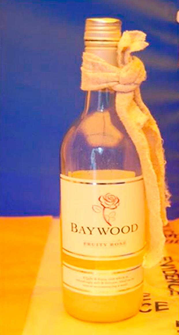 Undated handout photo issued by the Metropolitan Police of a wine bottle recovered from the scene of the London Bridge attacks.