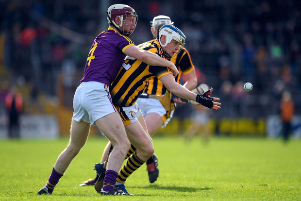 Kilkenny's TJ Reid of Kilkenny battles with Wexford's James Breen during their Allianz HL Division 1 quarter-final. Photo by Brendan Moran/Sportsfile