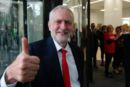 Jeremy Corbyn gives a thumbs up as he arrives at Labour Party headquarters. Picture: AFP