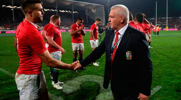 Warren Gatland (R) the Lions head coach congratulates Conor Murray after their victory
