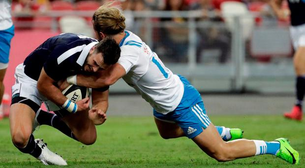 Scotland's Alex Dunbar in action with Italy's Michele Campagnaro. REUTERS/Jeremy Lee