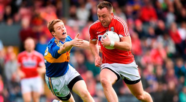 Paul Kerrigan of Cork in action against Brian Fox of Tipperary during the Munster GAA Football Senior Championship Semi-Final match between Cork and Tipperary at Pairc Ui Rinn in Cork. Photo by Matt Browne/Sportsfile