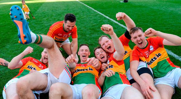 Carlow players celebrate after the Christy Ring Cup Final match between Antrim and Carlow at Croke Park in Dublin. Photo by Piaras Ó Mídheach/Sportsfile