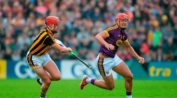 Lee Chin, right, of Wexford in action against Cillian Buckley of Kilkenny during the Leinster GAA Hurling Senior Championship Semi-Final match between Wexford and Kilkenny at Wexford Park in Wexford. Photo by Daire Brennan/Sportsfile