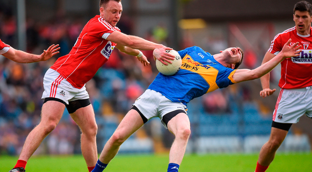 Jimmy Feehan of Tipperary reacts to a challenge from Cork's Paul Kerrigan. Photo: Sportsfile