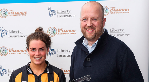 Katie Power is presented with the Player of the Match award by John Coffey of Liberty Insurance. Photo: James Crombie/INPHO