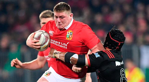 Tadhg Furlong of the Lions is tackled by Jordan Tafua of the Crusaders in Christchurch yesterday. Photo: Martin England/Reuters