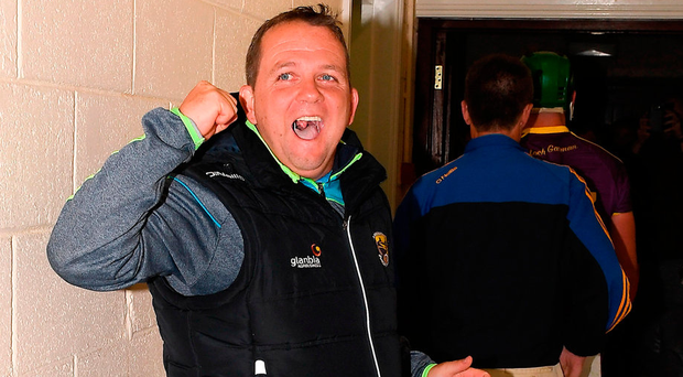 Davy Fitzgerald, whose suspension ended at midnight last night, celebrates in the tunnel after the game. Photo: Sportsfile