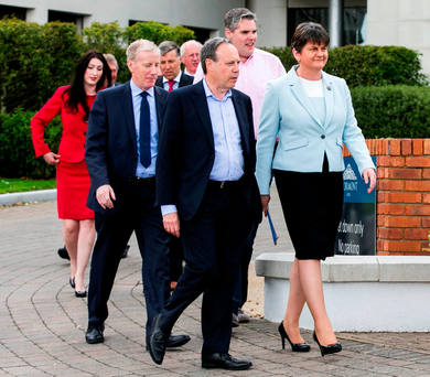 Leader of the Democratic Unionist Party Arlene Foster walks with newly elected Members of Parliament in Belfast, Northern Ireland. Photo: Reuters