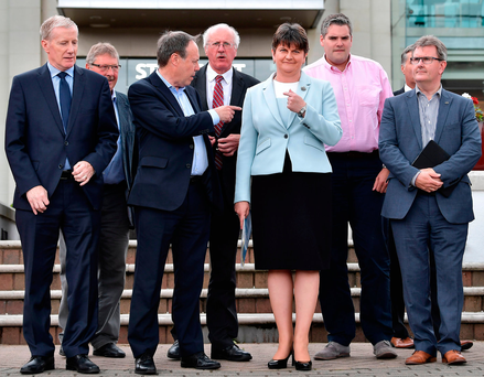Kingmakers: Nigel Dodds points to DUP leader Arlene Foster as they hold a photocall with their newly-elected candidates. Photo: Getty Images