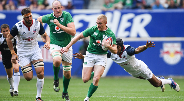 Keith Earls is tackled by Marcel Brache Photo by Ramsey Cardy/Sportsfile